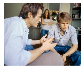 Photo of a father speaking to his son.
